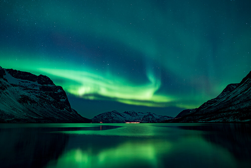 The aurora borealis dances across the winter sky in northern Norway. Photo by Ton van Moll and courtesy of Waterproof Cruises & Expeditions.